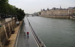Cycling along the Seine in the rain, Paris Stock Photos