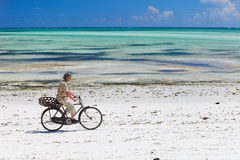 Cycling along tropical beach Royalty Free Stock Photo