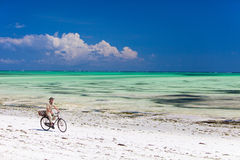 Cycling along tropical beach Royalty Free Stock Photography