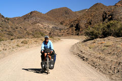 Cycling through argentinian mountains Stock Photo