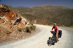 Cycling through argentinian mountains. Woman cycling on the remote road from Termas Villavicencio to Uspallata, Argentina Stock Photography