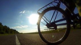 Cycling on asphalt stock footage