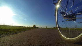 Cycling on asphalt stock video footage