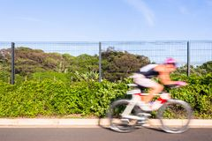 Cycling Athlete Motion Speed Blur Close-Up Action. Athlete cycling motion speed blur close-up action morning road course second leg of triathlon race royalty free stock photography