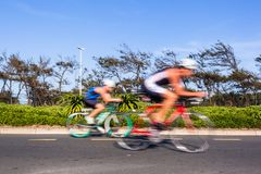 Cycling Athletes Motion Speed Blur Close-Up Action. Athletes cycling motion speed blur close-up action morning road course second leg of triathlon race stock images