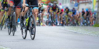 Cycling athletes in a race. Detail of cycling athletes in a contest royalty free stock photography
