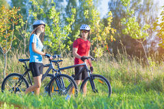 Cycling Athlets Exercising with Bicycles in Nature Environment O Stock Photos
