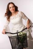 Cycling away bride Stock Image