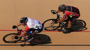 Cycling on a banked oval track Royalty Free Stock Photography