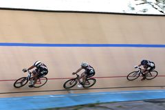 Cycling on the banked track. Professional Bikes race along the velodrome track at a cycle race at the professional Velodrone bicycle race track, USA Cycling Stock Photo