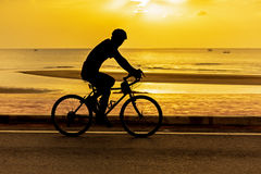 Cycling at beach on twilight Royalty Free Stock Images