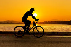 Cycling at beach on twilight Royalty Free Stock Photography