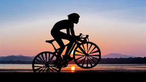 Cycling at beach on twilight time Royalty Free Stock Images