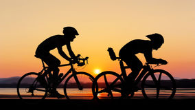 Cycling at the beach twilight time Royalty Free Stock Images