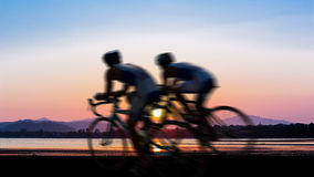Cycling at beach on twilight Stock Images