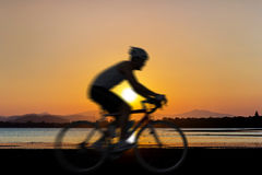 Cycling at beach on twilight Stock Photography