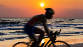 Cycling at beach on twilight Stock Photos