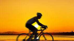 Cycling at the beach twilight time Stock Image