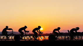 Cycling at the beach twilight time Royalty Free Stock Photo