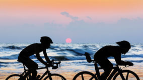 Cycling at the beach twilight time Stock Photos