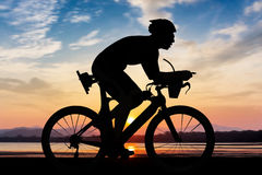 Cycling at the beach twilight time Stock Images
