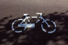 Cycling. Bicycle lane with bicyle icon Royalty Free Stock Photos
