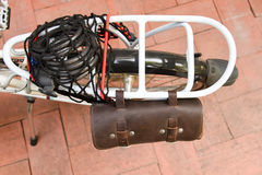 Cycling bicycle rear rack. Rear rack and leather bag of small bicycle stock photography