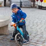 Cycling boy stops and looks angrily stock photography