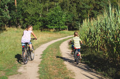 Cycling with children Stock Photo