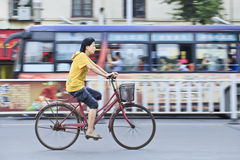 Cycling Chinese woman. XIANG YANG-CHINA-JULY 1, 2012. Woman on a bicycle on July 1, 2012 in Xiang Yang. 430 million owners of bicycles in China represent the Stock Image