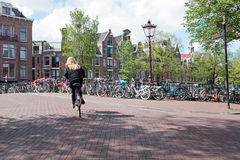 Cycling in the city center from Amsterdam Netherlands. Cycling in the city center from Amsterdam the Netherlands Stock Image