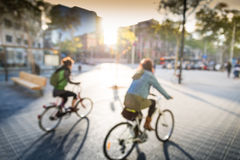 Cycling in city. Couple of girls are cycling in city Royalty Free Stock Image