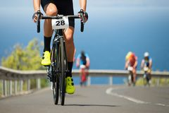 Cycling competition,cyclist athletes riding a race. Climbing up a hill on a bicycle Royalty Free Stock Image