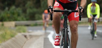 Cycling competition,cyclist athletes riding a race. In the light of evening Stock Photos