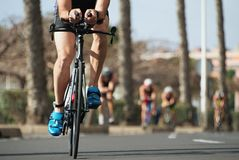 Cycling competition,cyclist athletes riding a race. Racing bike during ironman competition Stock Photo