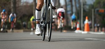 Cycling competition,cyclist athletes riding a race. Racing bike during ironman competition Royalty Free Stock Photo