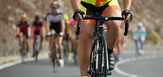 Cycling competition,cyclist athletes riding a race. At high speed Royalty Free Stock Photos