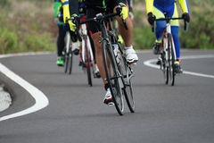 Cycling competition. Cyclist athletes riding a race at high speed stock photo