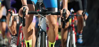 Cyclists with racing bikes during the cycling road race. Cycling competition,cyclist athletes riding a race at high speed Stock Images