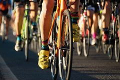 Cycling competition,cyclist athletes riding a race. In the light of evening stock photography
