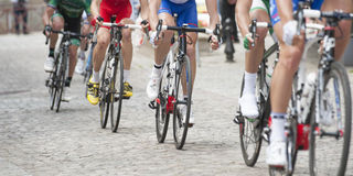 Cycling competition on pavement. Cycling competition on  cobblestone street Stock Photo