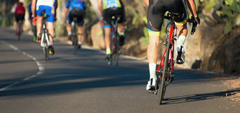Cycling competition race at high speed. View from behind Stock Photo