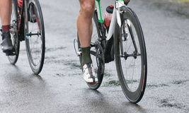 Cycling competition under the rain. Two runners at cycling competition under the rain Royalty Free Stock Photography