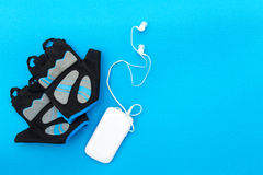Cycling concept. Bicycle gloves and mp player Royalty Free Stock Photo
