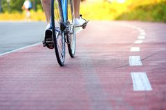Cycling concept, low angle view from behind stock photography