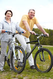 Cycling couple Royalty Free Stock Images