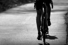 Cycling. A cyclist is cycling on the road Stock Image