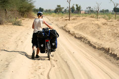 Cycling Through Desert. Cycling through remote desert road in India Stock Photography