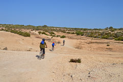 Cycling Through The Desert Royalty Free Stock Images