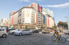 Cycling in the district of Ginza, Japan Royalty Free Stock Images
